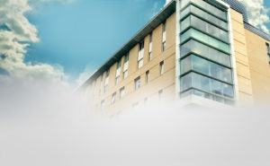 building-with-sky-and-clouds-ppt-business-powerpoint-templates